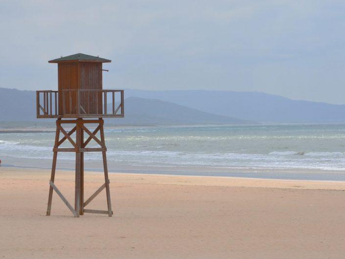 Three walking at the beach — Barbate, 2016